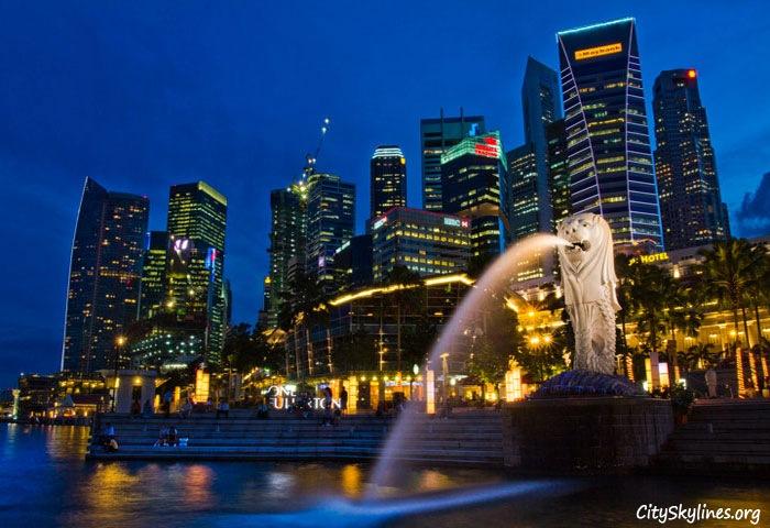 Singapore City Skyline at Night with Merlion